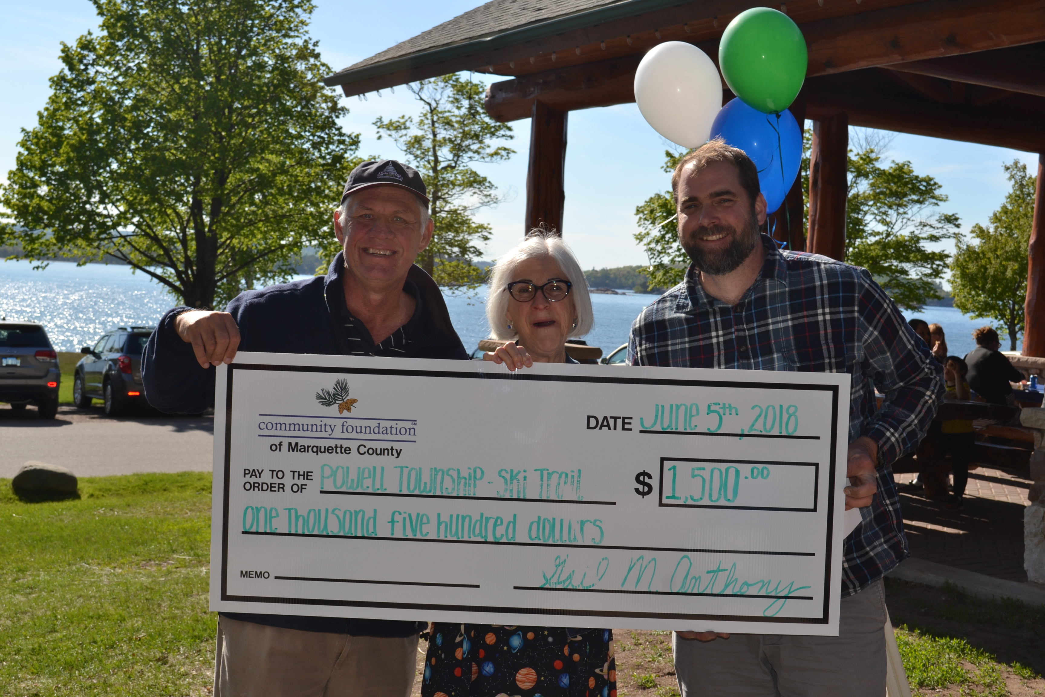 Bob Cowell (Community Advised Big Bay Fund and Robert Cowell and Kathleen Olivier Donor Advised Fund) presents the grant to Lucy Wilcox (Parks and Rec Committee) and Sven Gonstead